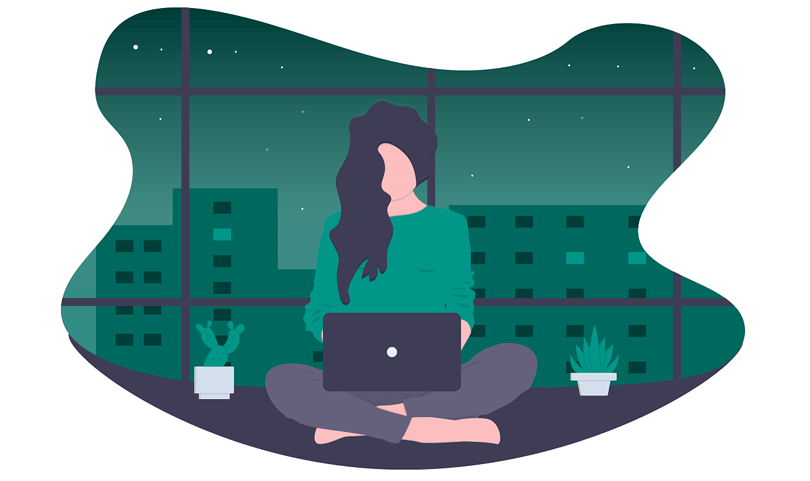 woman working on laptop at night